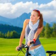 Cyclist girl in mountains — Stock Photo