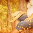 Pregnant girl in autumnal park — Stock Photo