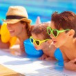 Happy family in pool — Stock Photo #30984389
