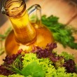 Olive oil and vegetarian salad — Stock Photo #30984397