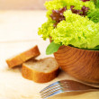 Lettuce salad with bread — Stock Photo #30984431