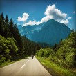 Stock Photo: Motorcyclist on mountainous highway