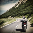 Racer on mountainous highway — Stock Photo
