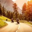 Group of motorcyclists on mountainous road — Stock Photo