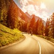 Stock Photo: Motorcyclists on the road in sunset
