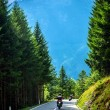 Stock Photo: Bikers on the road in Alps