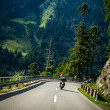 Постер, плакат: Motorcyclist on mountainous road