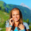 Beautiful woman in the mountains — Stock Photo