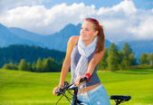 Cyclist girl in mountains — Foto Stock