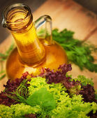Olive oil and vegetarian salad — Stock Photo