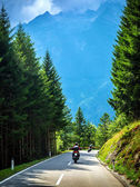 Bikers on the road in Alps — Stock Photo