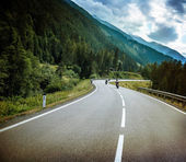Group of bikers on mountainous road — Stock Photo