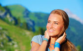 Portrait of woman in the mountains — Stock Photo