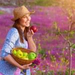 Happy woman eating apple — Stock Photo