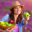 Girl offers an apple — Stock Photo