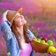 Attractive girl with apples basket — Stock Photo