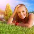 Stock Photo: Happy woman on green grass