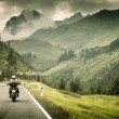 Постер, плакат: Motorcyclist on mountainous highway