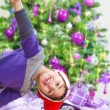 Happy boy near Christmas tree — Stock Photo