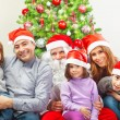 Stock Photo: Large family near Christmas tree