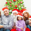 Large family near Christmas tree — Stock Photo