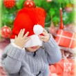 Naughty boy in Santa hat — Stock Photo