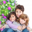 Happy kids near Christmas tree — Stock Photo