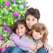 Stock Photo: Happy kids near Christmas tree