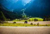 Motorcyclist on mountainous highway — Stock Photo