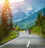 Group of bikers in Alps — Stock Photo