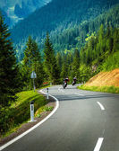 Group of motorcyclists in Alpine mountains — Stock Photo