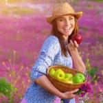Cheerful woman biting apple — Stock Photo