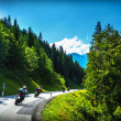 Постер, плакат: Bikers in mountainous tour
