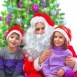 Adorable kids with Santa Claus — Stock Photo