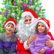 Stock Photo: Adorable kids with Santa Claus