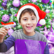 Boy enjoying Christmas gift — Stock Photo