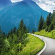 Постер, плакат: Motorcyclists in mountainous touring