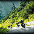 Постер, плакат: Group of moto bikers on mountainous road