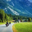 Stock Photo: Motorcyclists on mountainous road