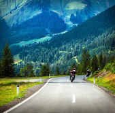 Group of bikers in mountains — Stock Photo
