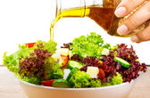 Fresh salad with olive oil — Stock Photo