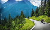 Motorcyclists in mountainous touring — Stock Photo