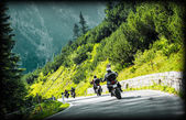 Group of moto bikers on mountainous road — Stock Photo