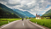 Bikers on mountainous highway — Stock Photo