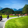 Motorcyclists on mountainous road — Stockfoto