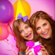Girl with mother celebrate birthday — Stock Photo #32680595