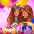 Girl with mom open birthday gift — Stock Photo