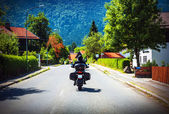 Motorcyclist touring along Austria — Stock Photo