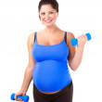 Pregnant woman do exercise — Stock Photo