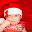 Newborn girl wear Santa hat — Stock Photo